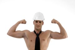 Muscular man wearing architect helmet. On an isolated background royalty free stock photo