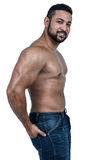 Muscular man wearing blue jeans. On white background Stock Image
