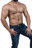 Muscular man wearing blue jeans Royalty Free Stock Images
