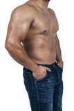 Muscular man wearing blue jeans Stock Photography