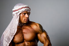 Muscular man wearing a middle eastern headdress Royalty Free Stock Photos