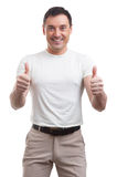 Muscular man wearing a white T-shirt. Muscular handsome man wearing a white T-shirt. isolated Royalty Free Stock Photography