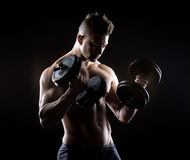 Muscular man weightlifting Royalty Free Stock Photos