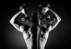 Muscular man weightlifting Royalty Free Stock Images