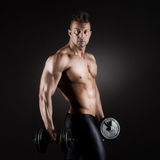 Muscular man weightlifting Stock Images
