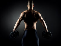 Muscular man weightlifting Stock Image
