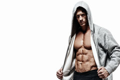 Muscular man on a white background. Stock Image