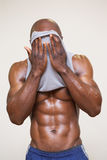 Muscular man wiping sweat after workout Stock Photography