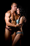 Muscular man and a woman Royalty Free Stock Photography