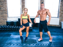 Muscular man and woman holding container with protein Stock Photos