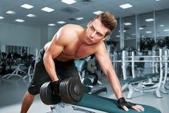 Muscular Man Working His Biceps Royalty Free Stock Image