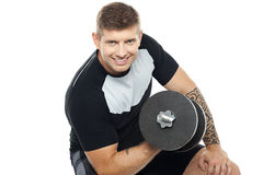 Muscular man working out with barbell. Isolated against white background Royalty Free Stock Photo