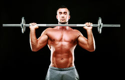 Muscular man working out with barbell Royalty Free Stock Photography