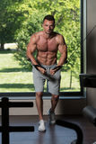 Muscular Man Working Out Chest On Cable Machine Stock Photos
