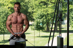 Muscular Man Working Out Chest On Cable Machine Royalty Free Stock Photos