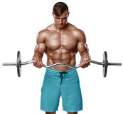 Muscular man working out doing exercises with barbell at biceps, strong male naked torso abs, isolated over white background.  Royalty Free Stock Image