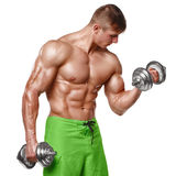 Muscular man working out doing exercises with dumbbells at biceps, strong male naked torso abs, isolated over white background.  stock images