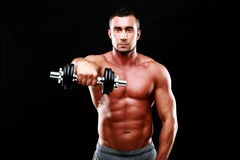 Muscular man working out with dumbbell Royalty Free Stock Photo