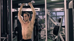 Muscular Man Working Out With Dumbbells stock footage