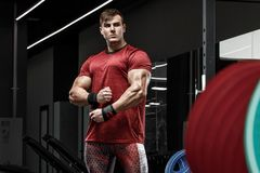 Muscular man working out in gym, strong bodybuilder male Stock Photography