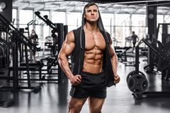 Muscular man working out in gym, strong male naked torso abs royalty free stock photos