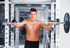 Muscular man working  with a rod Royalty Free Stock Photo