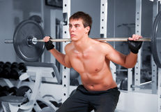 Muscular Man Working With The Rod Royalty Free Stock Photos
