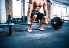 Muscular man workout with barbell. Closeup portrait of a muscular man workout with barbell at gym Stock Photography