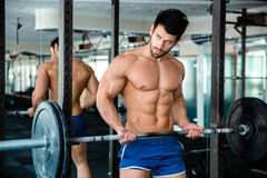 Muscular man workout with barbell Royalty Free Stock Photography