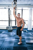 Muscular man workout on fitness ring Royalty Free Stock Image