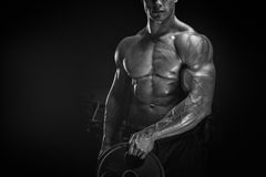 Free Muscular Man Workout With Barbell Plate Stock Image - 66863351