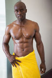 Muscular man wrapped in yellow towel Royalty Free Stock Photos