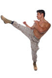 Muscular Marine high kick in Uniform. Isolated on white Royalty Free Stock Image
