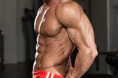 Muscular Mature Man Performing Side Triceps Pose Stock Image