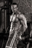 Muscular Mature Man Performing Side Triceps Pose Stock Photography