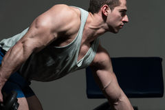 Muscular Men Doing Heavy Weight Exercise For Triceps Stock Photography