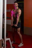 Muscular Men Doing Heavy Weight Exercise For Triceps Royalty Free Stock Photos