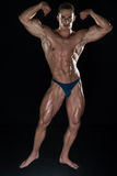 Muscular Men Is Hitting Rear Double Bicep Pose Royalty Free Stock Image