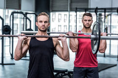 Muscular men lifting a barbell Royalty Free Stock Image