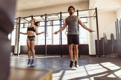 Athletes training hard at the gym Stock Image