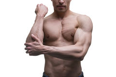 Muscular middle-aged man posing on white background, isolated studio shot Stock Image