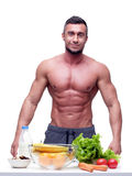 Muscular mn with healthy food Royalty Free Stock Images