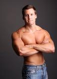 Muscular model. Posing in studio Royalty Free Stock Image