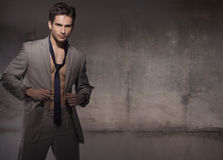Muscular model wearing trendy suit Royalty Free Stock Images