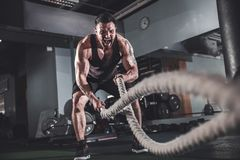 Men with rope in functional training gym stock photos
