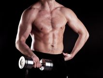 Muscular powerful man lifting metal weights Royalty Free Stock Photo