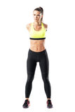 Muscular pretty sporty female runner stretching arm with crossed hands behind back Stock Photo