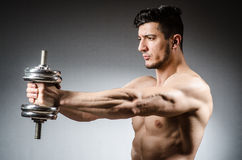 Muscular ripped bodybuilder with dumbbells Stock Image