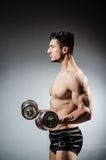 Muscular ripped bodybuilder with dumbbells Stock Photo