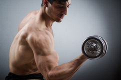 Muscular ripped bodybuilder with dumbbells Royalty Free Stock Photo